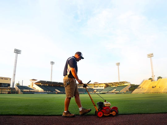 Head grounds keeper Brian French edges the grass at the Tigers' spring training complex in Lakeland, Fla .