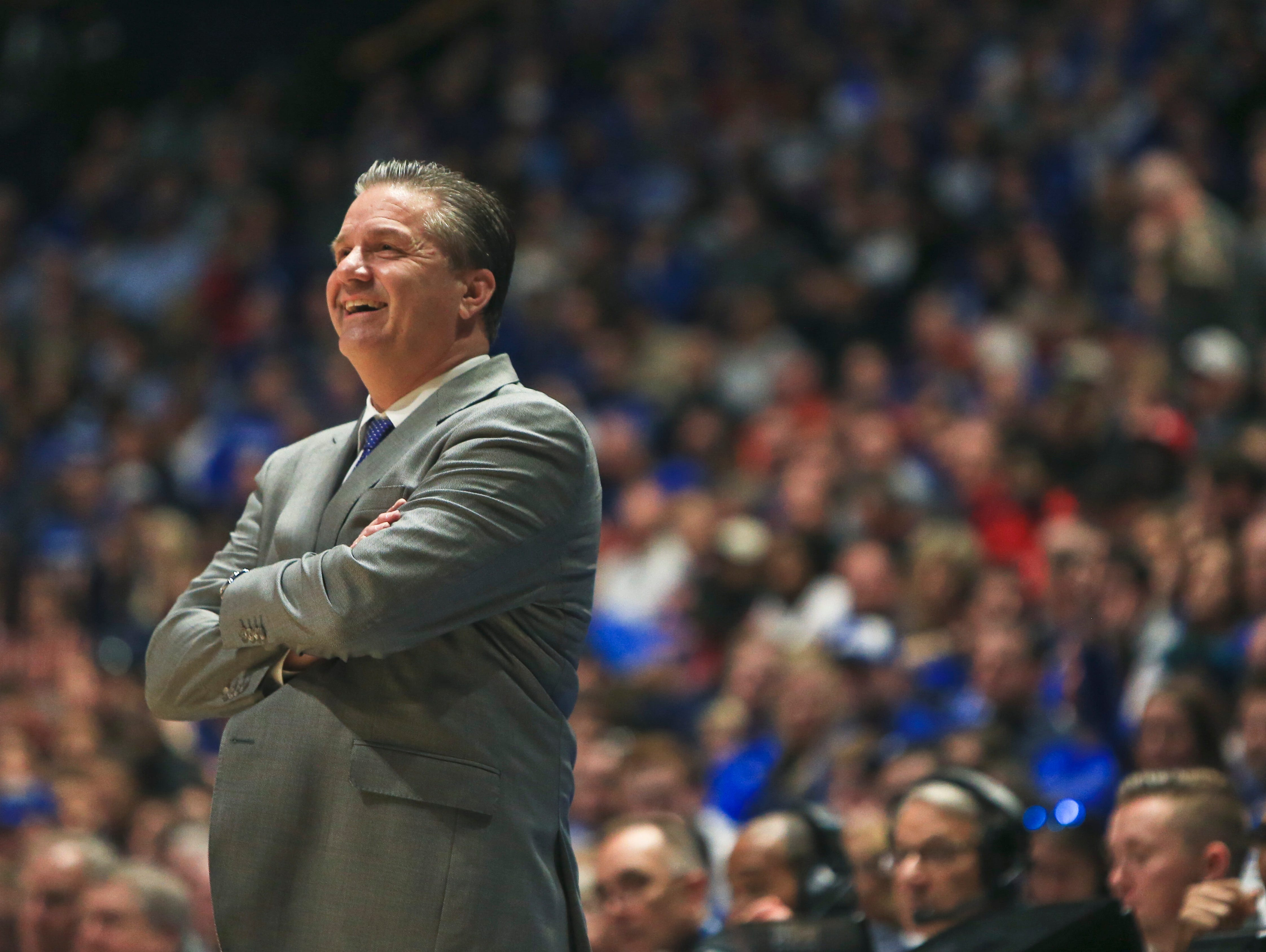John Calipari find some reasons to smile as the Wildcats rolled past Georgia Friday.