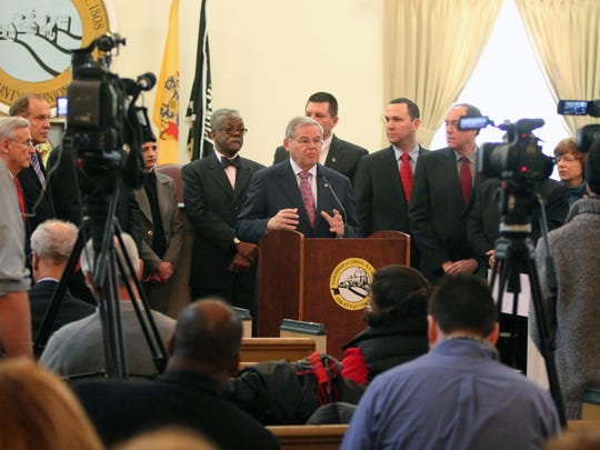 Inside of the Union Township Municipal building U.S. Sen. Bob Menendez, and mayors from Rahway, Springfield, Cranford, Kenilworth, Orange and Union Township were on hand talking about new federal funding to address long-term flooding concerns along the 82-square mile Rahway River Basin through Union, Essex and Middlesex counties. Here Menendez (center) surrounded by local mayors and other dignitaries speaks to a packed room during the meeting. On Friday Feb. 6 ,2015 Photo: Mark R. Sullivan/Staff Photographer