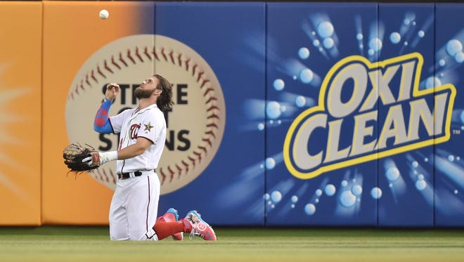 Bryce Harper makes a diving catch to rob Salvador Perez in the second inning.