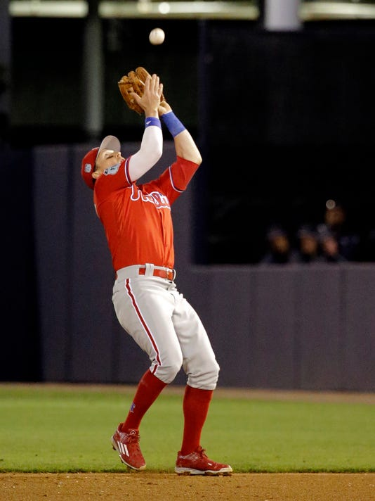 FILE - In this March 15, 2017, file photo, Philadelphia Phillies second baseman Chris Coghlan catches a pop fly in the fifth inning of a spring training baseball game in Tampa, Fla. Coghlan spent spring training with the Phillies using a wrist band to measure his sleep and recovery.(AP Photo/John Raoux)