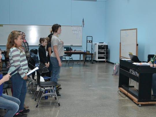 New music teacher Stacey Burns leads her choir class