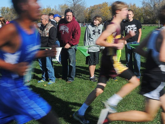 Fans look on and cheer during the Class B boys state cross country meet Saturday at Yankton Trail Park. Daniel Burkhalter of Bison won with a time of 16:54.84.