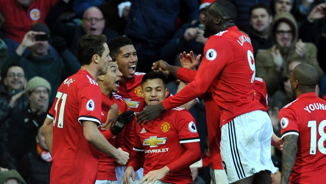 Manchester United's Jesse Lingard, second left, celebrates with his teammates after scoring his side's second goal.