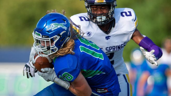 Blue Springs South's Luke Fellers, front, hauls in a pass in last year's game against crosstown rival Blue Springs. Fellers will be throwing the passes this season as the starting quarterback for the Jaguars, who look to build on a strong finish to last season.