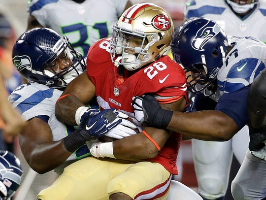 San Francisco 49ers running back Carlos Hyde (28) is
