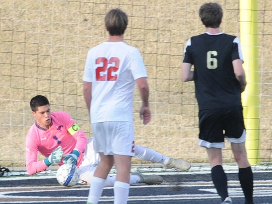 Cooper goalie Nick Silva makes a stop in the first half against Lubbock High. Cooper beat the Westerners 2-0 in the District 4-5A soccer game Friday, Feb. 9, 2018 at Shotwell Stadium.