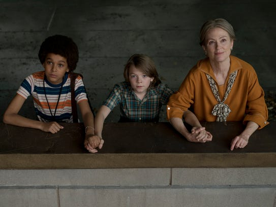 Jamie (Jaden Michael, left), Ben (Oakes Fegley) and Rose (Julianne Moore) connect in unexpected ways in the children's adventure 'Wonderstruck.' Fegley and Moore both play deaf characters.
