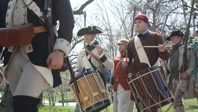 Members of the Illinois Regiment Revolutionary War reenactment group, along with a group of county militia, march on the grounds of Locust Grove during the 22nd annual â??18th Century Thunderâ? in celebration of George Rogers Clark on Saturday.  April 12, 2014.