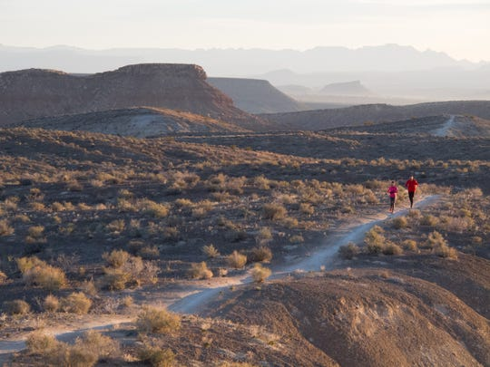 Spurred to run by a post on the Facebook page for the St. George Running Club, a group of about a dozen runners took on a 20 mile trail run early Wednesday, Nov. 26, 2014 on the Bear Claw Poppy and Stucki Springs Trails in St. George.