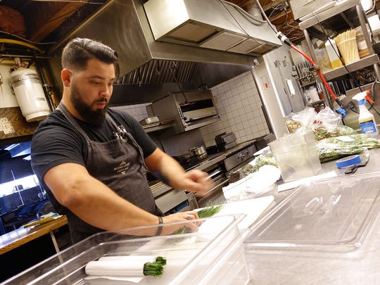 Executive chef Chris McKinley prepares fresh herbs