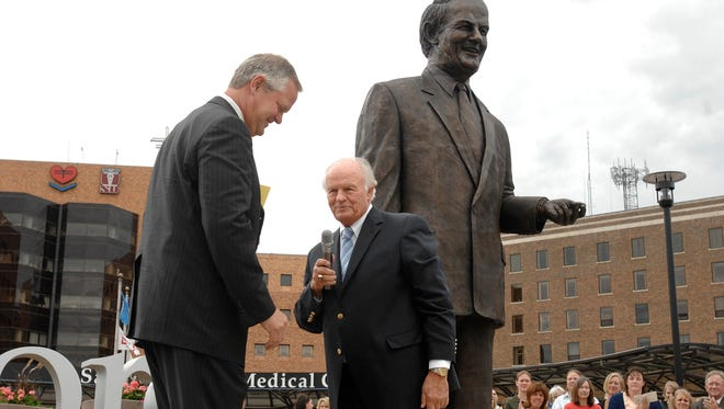 T. Denny Sanford (right) talks with Kelby Krabbenhoft and the crowd during the unveiling of the 'Welcoming Denny' statue at Sanford Health in 2008.