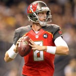 Buccaneers quarterback Mike Glennon  looks to throw against the New Orleans Saints at the Mercedes-Benz Superdome.