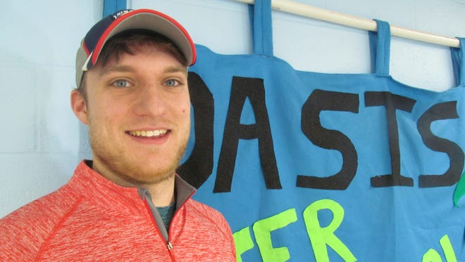 Jake Pine, a senior at Binghamton University, volunteers for the OASIS After-School program at the Boys & Girls Club of Western Broome in Endicott.
