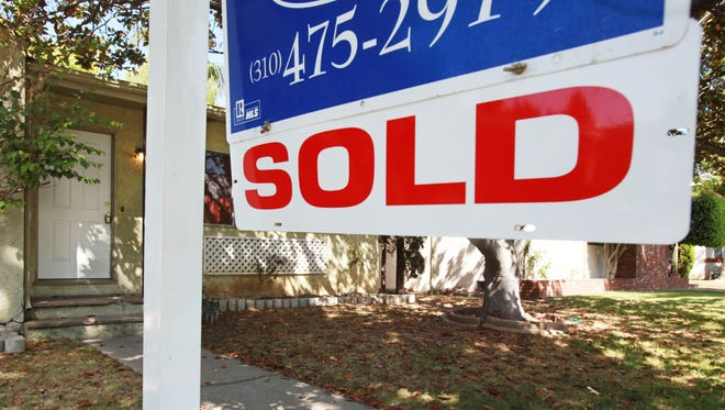 """In this June 23, 2009 photo, a """"sold"""" sign is seen on a home for sale in Los Angeles. A real estate group's report says sales of previously occupied homes rose 3.6 percent from May to June, the third consecutive monthly increase and a sign that a housing recovery is under way in much of the country.(AP Photo/Reed Saxon)"""