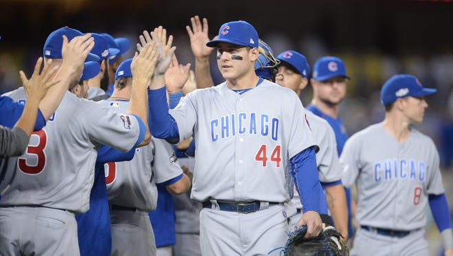 Anthony Rizzo and the Cubs celebrate Game 4 win.
