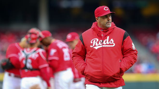 Cincinnati Reds manager Bryan Price (38) walks back to the dugout after a pitching change in the eighth inning during the National League baseball game between the Chicago Cubs and the Cincinnati Reds, Monday, April 2, 2018, at Great American Ball Park in Cincinnati. The Cincinnati Reds won 1-0.