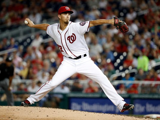 Washington Nationals starting pitcher A.J. Cole throws during the third inning of a baseball game against the Washington Nationals at Nationals Park, Tuesday, Sept. 13, 2016, in Washington. (AP Photo/Alex Brandon)