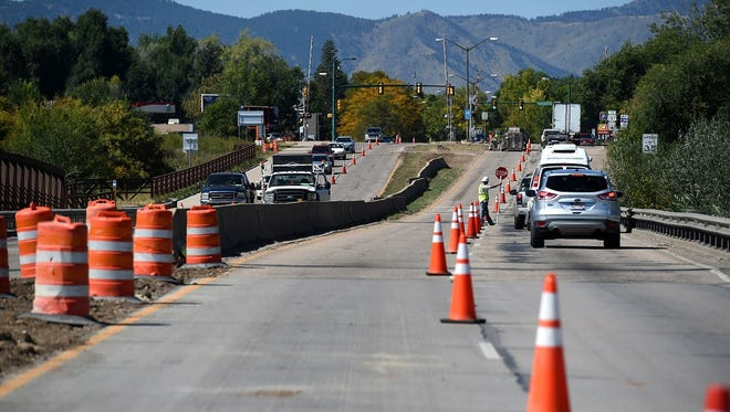 Erin Hooley/The Coloradoan Construction on the Mulberry Street bridge over the Poudre River between Riverside and Lemay avenues limits traffic on Thursday, Sept. 18. The  bridge will be replaced in a project that is expected to run to November 2015. Construction on the Mulberry Street Bridge over the Poudre River between Riverside Avenue and Lemay Avenue Thursday, Sept. 18, 2014. The Colorado Department of Transportation plans to replace the bridge in a project that is expected to run to November 2015.