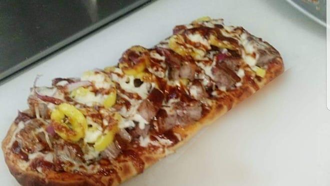 The Smokehouse 228 menu offers a BBQ pizza.