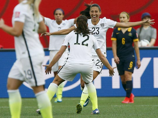 United States' Christen Press (23) celebrates with Lauren Holiday (12) after scoring during Monday's Women's World Cup match in Winnipeg, Manitoba. The U.S. won, 3-1.