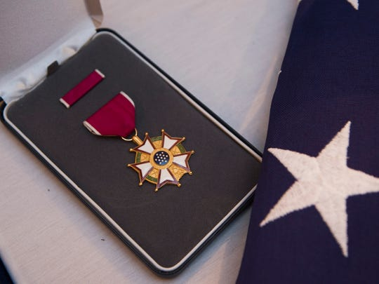 The Legion of Merit, posthumously awarded to Stephanie Rader, was displayed during a reception following her full-honors funeral services.