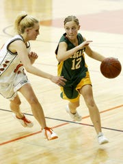 In this 2006 file photo, Connie Urmanski moves the ball upcourt in a game against Stratford.