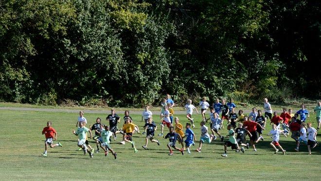 Boys start the Boston Run Thursday, Sept. 24, 2015 at Glen Miller Park.