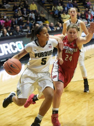 Purdue's Justine Hall looks to get around a defender Monday, November 16th, 2015 at Mackey Arena in West Lafayette. The Boilermakers were victorious 67-48.