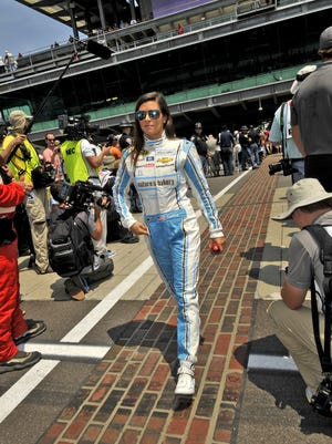 Danica Patrick walks along the bricks to her car for the start of the Brickyard 400, Sunday, July 24, 2016.