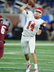 Orchard Lake St Mary's quarterback Caden Prieskorn (14) throws against Muskegon.