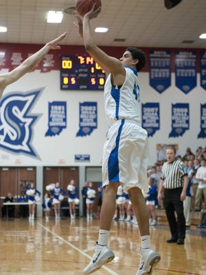 Hamilton Southeastern freshman Zach Gunn shoots a jumper during Carmel's 55-54 victory over host Hamilton Southeastern, Thursday, Feb. 13, 2014.