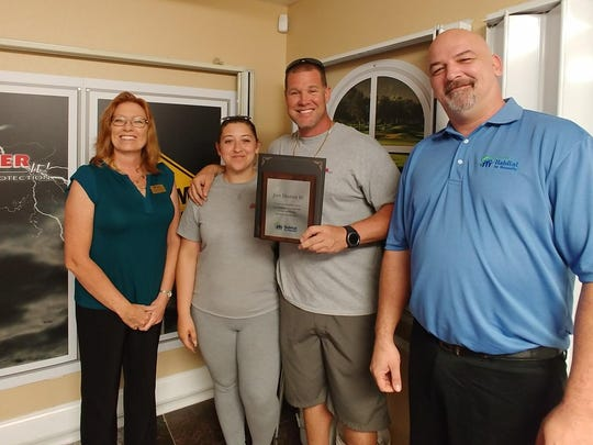Just Shutter It! participates in the St. Lucie Habitat for Humanity In-kind Corporate Donor Program. Pictured are, from left, Habitat's Melissa Winstead, Parish Nichols and Paul Nichols of Just Shutter It! and Habitat's Will McLaughlin.