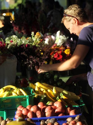 Cinda Nofziger of Iowa City browses at the farmer's market on Wednesday, Sept. 12, 2012.