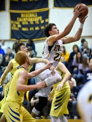 Elco's Nathan Beamer drives to the basket in the second half of the Raiders-Vikings match up at Elco High School Thursday evening, Jan. 12.