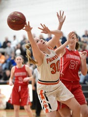 Palmyra Cougar Sara Boyer stretches for a rebound against Fleetwood Tuesday night, Feb. 20 at Palmyra.