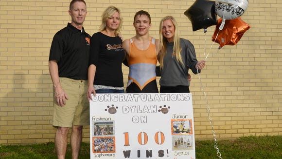 Central's Dylan Chatterton celebrates his 100th high school wrestling victory with his family