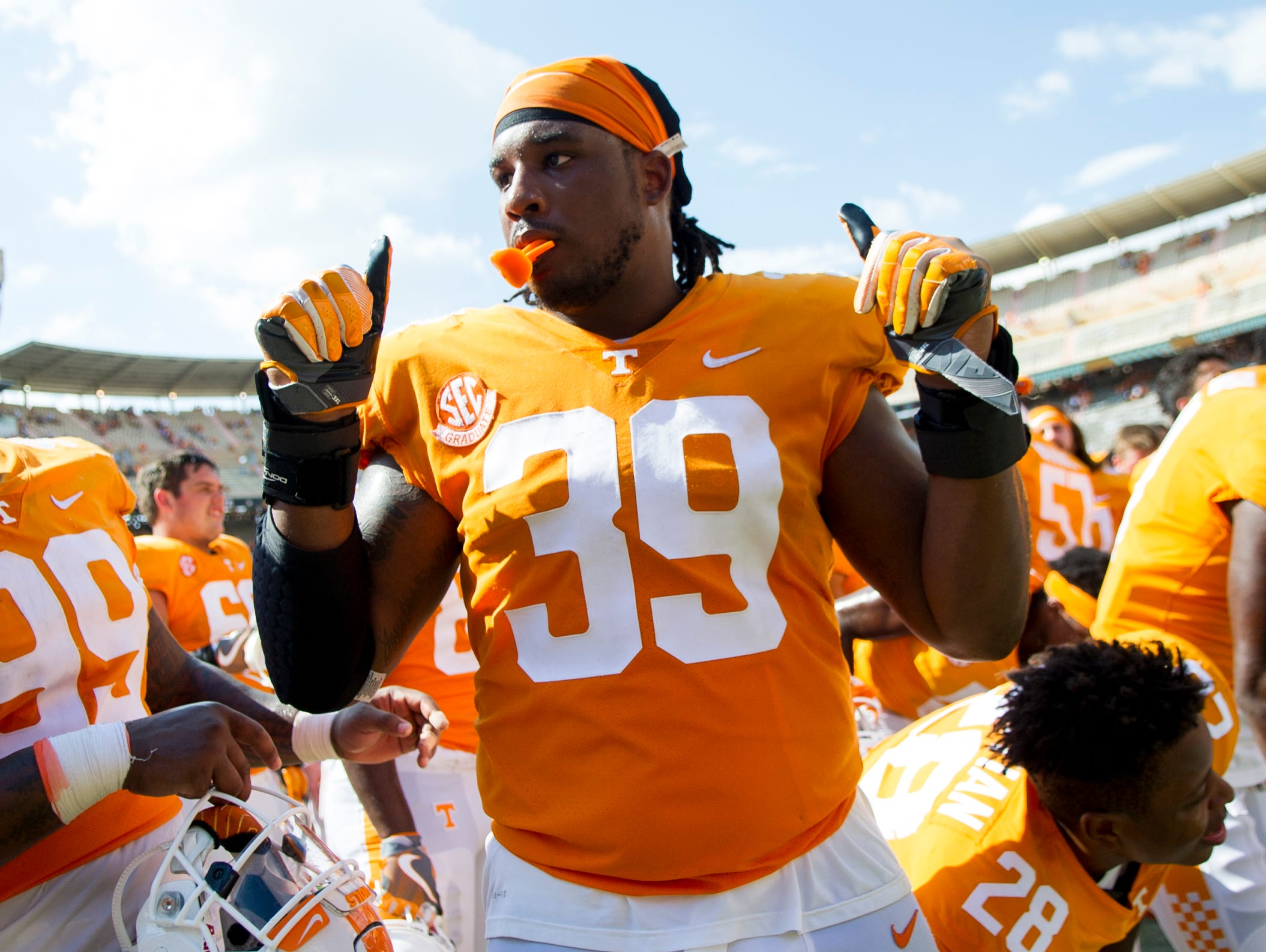 Tennessee defensive lineman Kendal Vickers (39) celebrates after Tennessee's 17-13 win against UMass in Neyland Stadium on Saturday, Sept. 23, 2017.