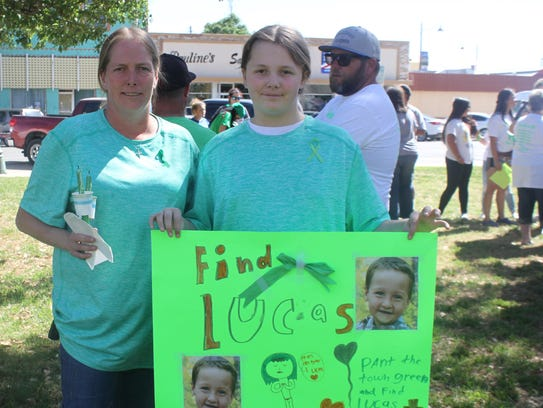 Rita and 10-year-old Shyann Crouch attend a vigil for
