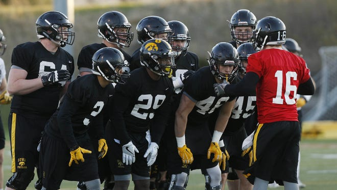Iowa quarterback C.J. Beathard gives the play to his teammates during Friday's Valley Stadium practice.