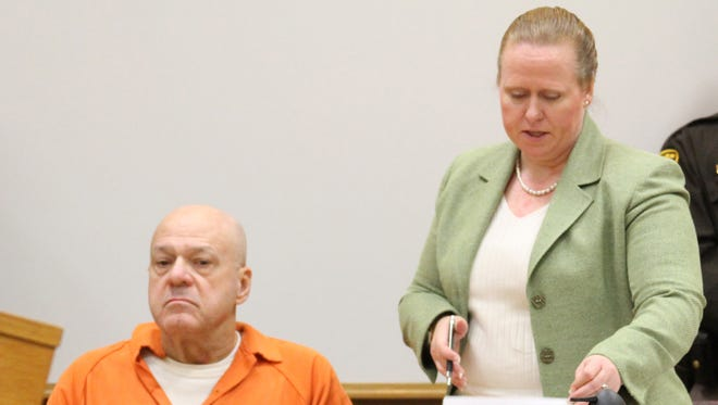 Marion Township resident Martin Edward Zale, seated, listens as his attorney, Melissa Pearce, addresses the court after testimony during his preliminary exam in Livingston County District Court. Zale is charged with open murder for the September fatal shooting of Derek Flemming during an alleged road-rage incident.
