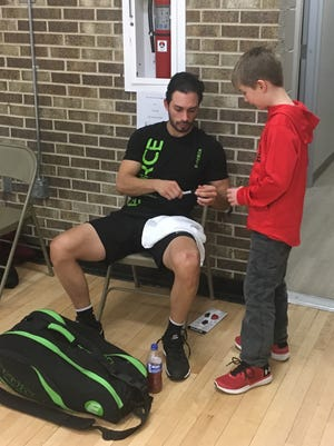 Lewis Drug pro singles champion Alex Landa signed an autograph for a young fan moments after defeating Daniel De La Rosa in the finals on Sunday.
