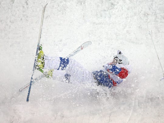 Sergey Volkov of Russia crashes out in the Men's Moguls Qualification on day three of the Sochi 2014 Winter Olympics at Rosa Khutor Extreme Park on February 10, 2014 in Sochi, Russia.