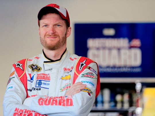 Dale Earnhardt Jr., driver of the #88 National Guard Chevrolet, stands in the garage area during practice for the NASCAR Sprint Cup Series Daytona 500 at Daytona International Speedway on February 15, 2014 in Daytona Beach, Florida.