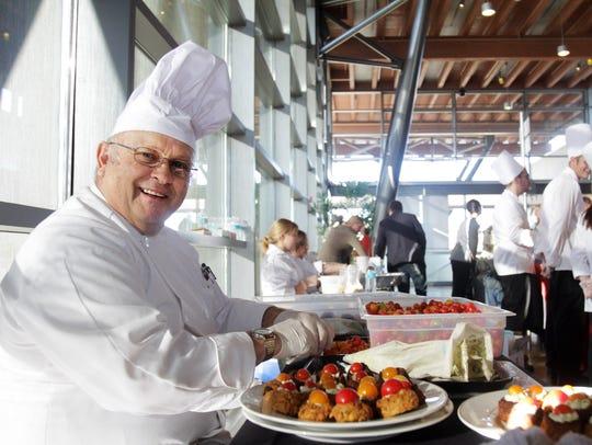 Bob Simon slices tomatoes for quinoa veggie patties