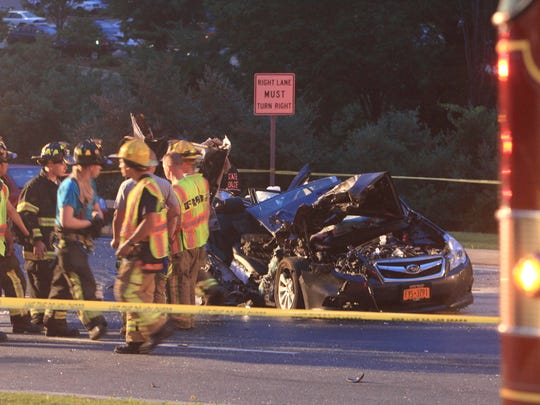 Brewster firefighters at the scene of the crash on Route 22 in Southeast June 27, 2013.
