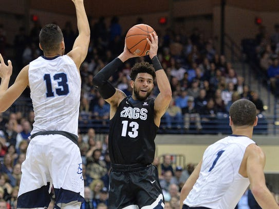 Gonzaga guard Josh Perkins is defended by San Diego