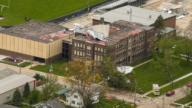 Aerial view of damage to South Central Calhoun High School in Lake City on Monday morning after a tornado swept through the town and tore the roof from the structure.