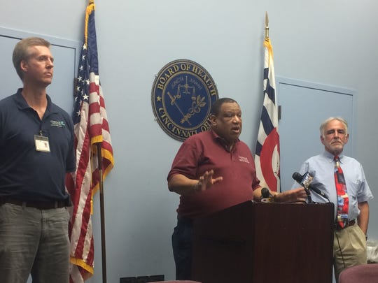 Interim Health Commissioner Dr. O'dell Owens, center, speaks at a news conference this summer at the Cincinnati Health Department about the first case of Zika virus in Cincinnati. Owens, who was a candidate for the permanent job, instead left recently to take a job with Interact for Health.