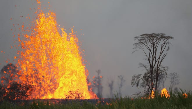 Lava from a Kilauea volcano fissure erupts on Hawaii's Big Island on May 19, 2018, in Kapoho.